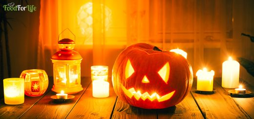 Amazing Pumpkin for Halloween with Candles on Wooden Background using for Wallpaper with Free Space for Text